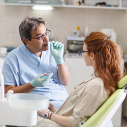 Doctor talking to patient about oral cancer symptoms